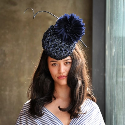 navy percher with large flower and quill