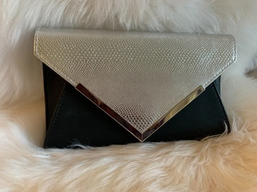 For Rent: Black and Silver clutch